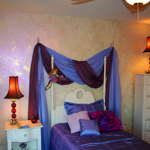Metallic iridescent wax over gold provide a gorgeous changing color chameleon effect on a girls' bedroom walls.