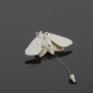 Kinetic Moth Badge, 2013, materials:porcelain, string, silver plated brooch back, photo James Mann.