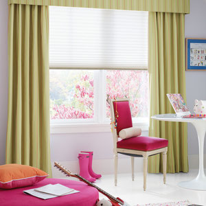 Hunter Douglas Roman Shades with green curtains in a contemporary kids room