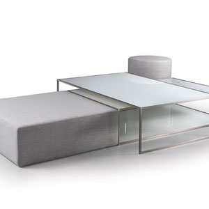 modern canadian white glass coffee table combined with gray fabric ottoman