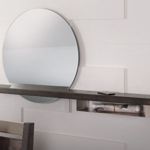 round modern mirror with wood and metal shelves