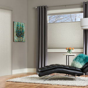 Hunter Douglas Duette Honeycomb window treatment with gray curtains in a modern setting