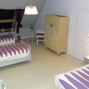 Les deux lits simples de la chambre Parme
