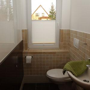 zusätzliche separate Toilette