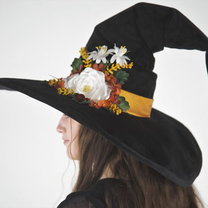 Velvet witch hat with sculpted buckram cone and hand-made flowers.