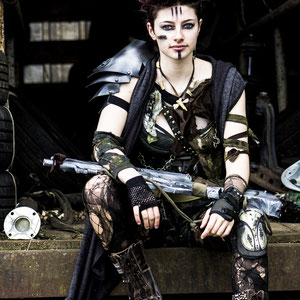 Heavily distressed post-apocalyptic costume and prop made with recycled materials.