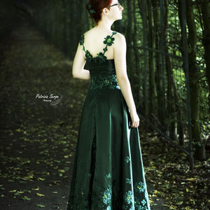 Circle skirt evening dress with hand sewn clover appliques .