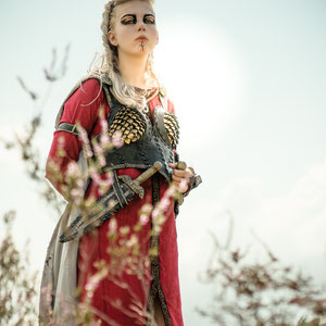 Viking costume made with hand dyed linen and leatherwork.