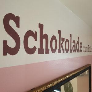 Maler Schriftzug auf Wand