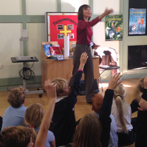Jackie Burke, author of The Secrets of Grindlewood series for children, taking questions during a school visit