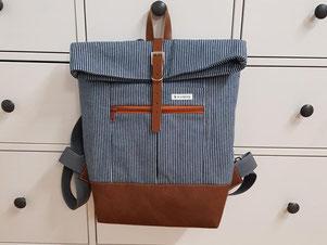 Rucksack aus Wachstuch statt Handtasche in leuchtenden Farben und erst noch wasserabweisend