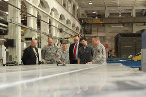 RIA-JMTC Commander, Col. James O. Fly, demonstrates the flatness of FSWed plates to the Department of Army Inspector General, Lt. Gen. Peter M. Vangjel, during a visit to the Rock Island Arsenal Joint Manufacturing and Technology Center on 31 January 2013
