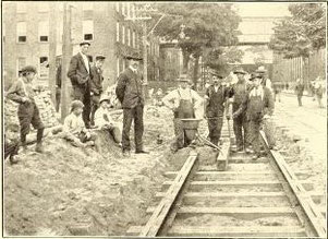 Railway workers and George Pellissier (centre left) stand next to a thermite crucible prior to ignition during the laying of the first tracks in the United States using the thermite welding technique in August 1904