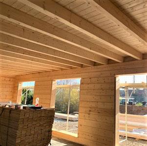 Hier entsteht ein ökologisches Blockhaus - Lamellenbalken mit Balkenstärke 275x220 mm². Blockhausbau - Hersteller - Blockhausbauer - Massive Blockbohlenhäuser - Werkplanung - Werkplaner - Bauberater - Fachberater - Architekt