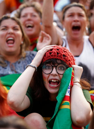 Portuguese soccer fans react during the semi final Euro 2012 soccer match between the Portugal and Spain at a public screening in Lisbon June 27, 2012.