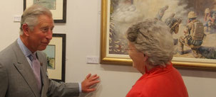 HRH The Prince of Wales discussing my painting of a military scene in Afghanistan