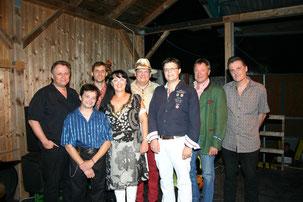 Georgia Kazantzidu und Matthias Laurenz Gräff (zentral) mit der Mojo Blues Band um Erik Trauner  und Siggi Fassl und den Garser Bürgermeister Martin Falk