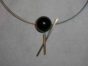 collar,- steel, gold and onix. 1985