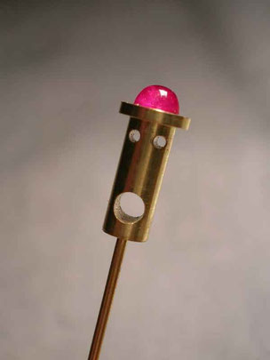 pin,- gold and ruby. 2001