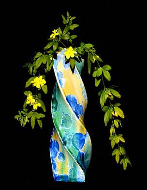 Vase formé de 2 bandes de couleures différentes qui s'enroulent