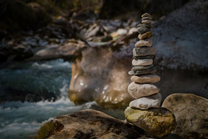 Finely balanced pebbles depicting the balance achieved in mind and body in Internal Martial Arts