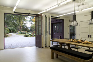 Adaptive Re-use of a garage into a visitor center with a classroom.