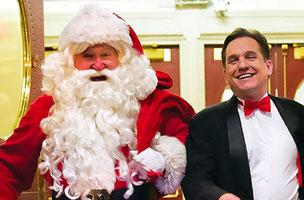 A close-up of Keith Lockhart with Santa