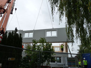 Assembling prefabricated house on site - day 2 at Stommel Haus
