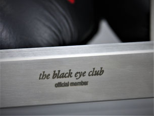 Close-up of the lettering -the black eye cub- on a stainless steel boxing glove stand