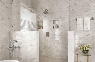 Glossy white ceramic tiles with a marble look in a traditional style bathroom.