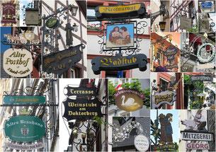 Typische Werbeschilder von Geschäften und Restaurants.