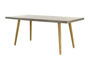 Cette table de L.180, comporte un plateau en béton allégé et un piètement en chêne massif. Cette table se décline également en table basse.