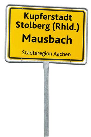 """So sollen sie in Zukunft aussehen, die neuen Ortstafeln im Stolberger Stadtgebiet. Ganz oben wird """"Kupferstadt Stolberg (Rhld.)"""" zu lesen sein. Fotomontage: Günter Herfs"""