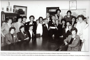 Members of the Committee presenting the President of GOCSA with the donation of $5000 cheque im 1986