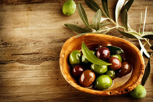 Olives and olive tree branches. Best Mediterranean extra virgin olive oils.