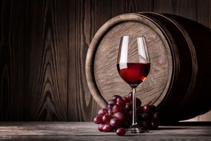 Red wine with grape and barrel. Best wine pairings. Mediterranean selection of signature wines, champagnes, cavas and liquors.