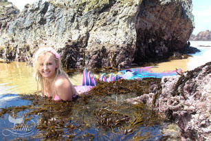 Jamie Jaime the Mermaid swimming at Camel Rock Beach, New South Wales, Australia. Blonde underwater mermaid. Pink, purple, blue aqua mermaid tail.