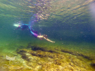 Jamie Jaime the Mermaid swimming at Blue Pool, New South Wales, Australia. Blonde underwater mermaid. Pink, purple, blue aqua mermaid tail.
