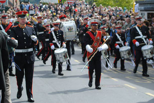 Coventry Corps of Drums marching for a large crowd in Stratford-Upon-Avon