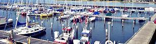 der Yachthafen Wackerballig mit anliegenden Booten