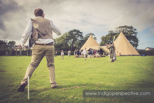 groomsmen play cricket by tipi in north devon wedding photography