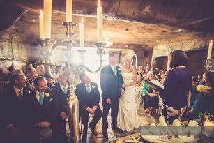 bride and groom in ceremony at ocean kave north devon wedding photography
