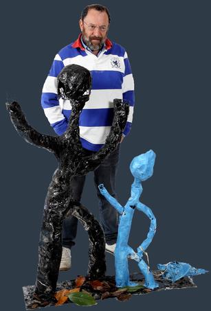 sculpture uomo bambino e il cane