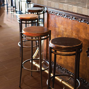 Wood porcelain in a restaurant under bar stools.
