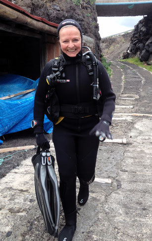 Happy diver on the way to the water
