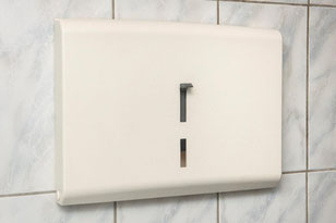 Toilet seat cover dispenser with lever