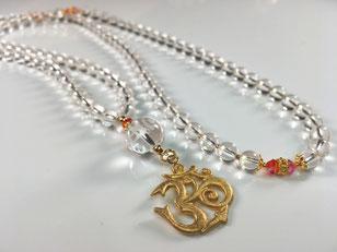 bergkristall-mala-om-symbol