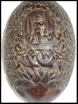 noix de coco sculptée art populaire bagne