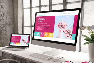 Eine neue Website ist auf einem Tablet und auf einem Desktop-Bildschirm sichtbar.