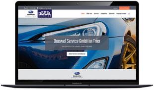 Website der Firma Daewel-Servide in Trier, sichtbar in Laptopmonitor